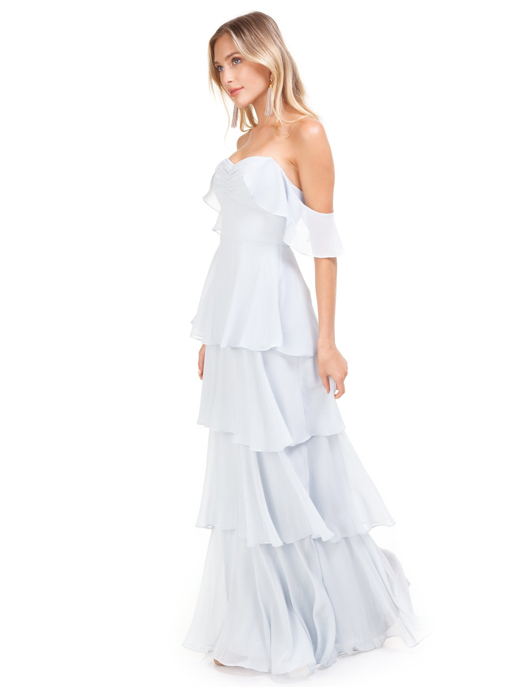 Woman wearing a dress rental from WAYF called Abby Off Shoulder Tiered Maxi Dress