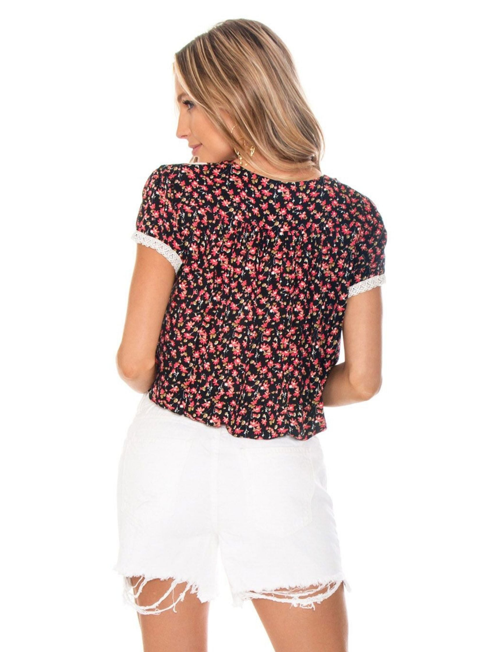 Women outfit in a top rental from Free People called The Ana Black Floral Print Button-up Top