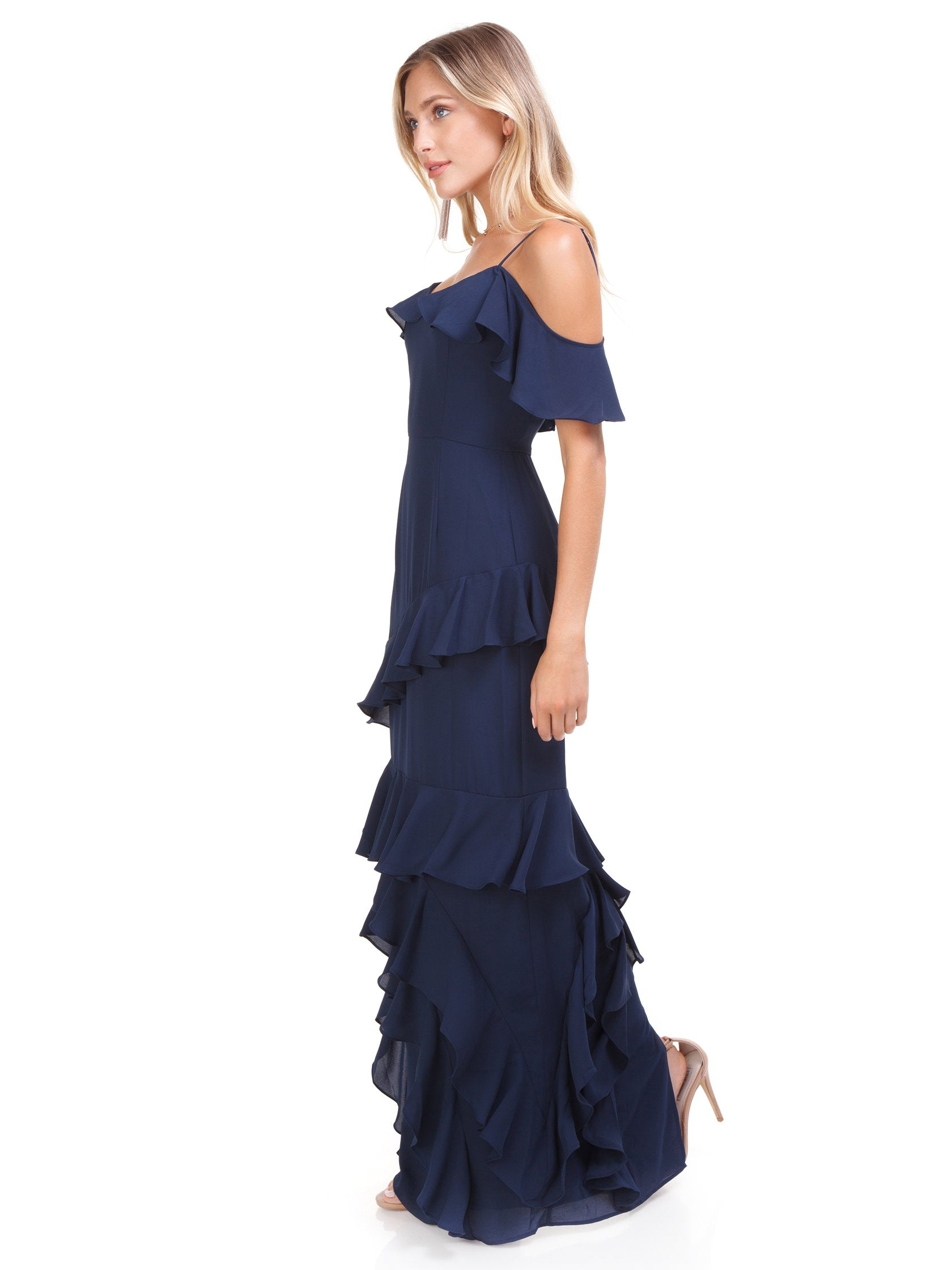 Woman wearing a dress rental from WAYF called Danielle Off Shoulder Tiered Ruffle Maxi Dress