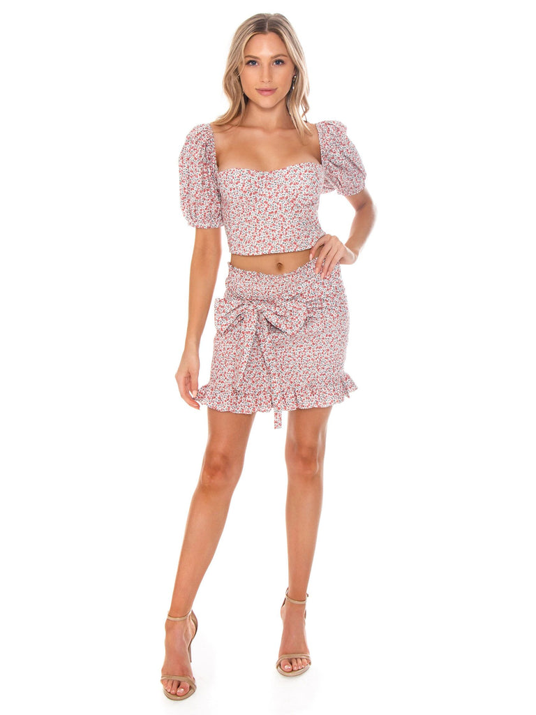 Women outfit in a two piece rental from Lani The Label called The Petal Top