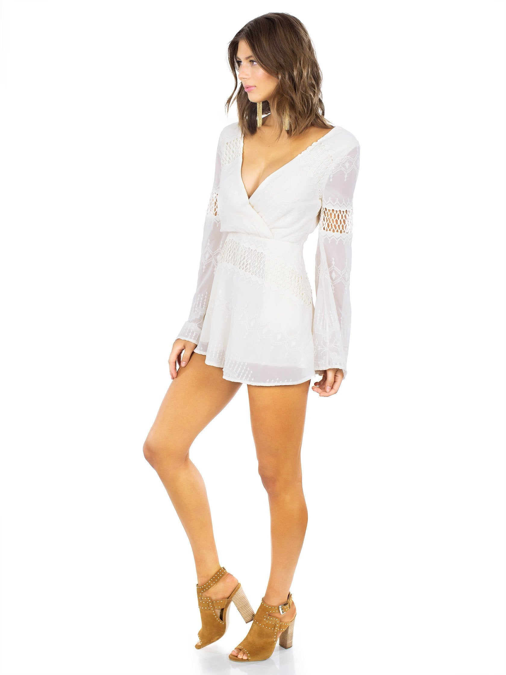 Woman wearing a romper rental from The Jetset Diaries called Dokuma Romper