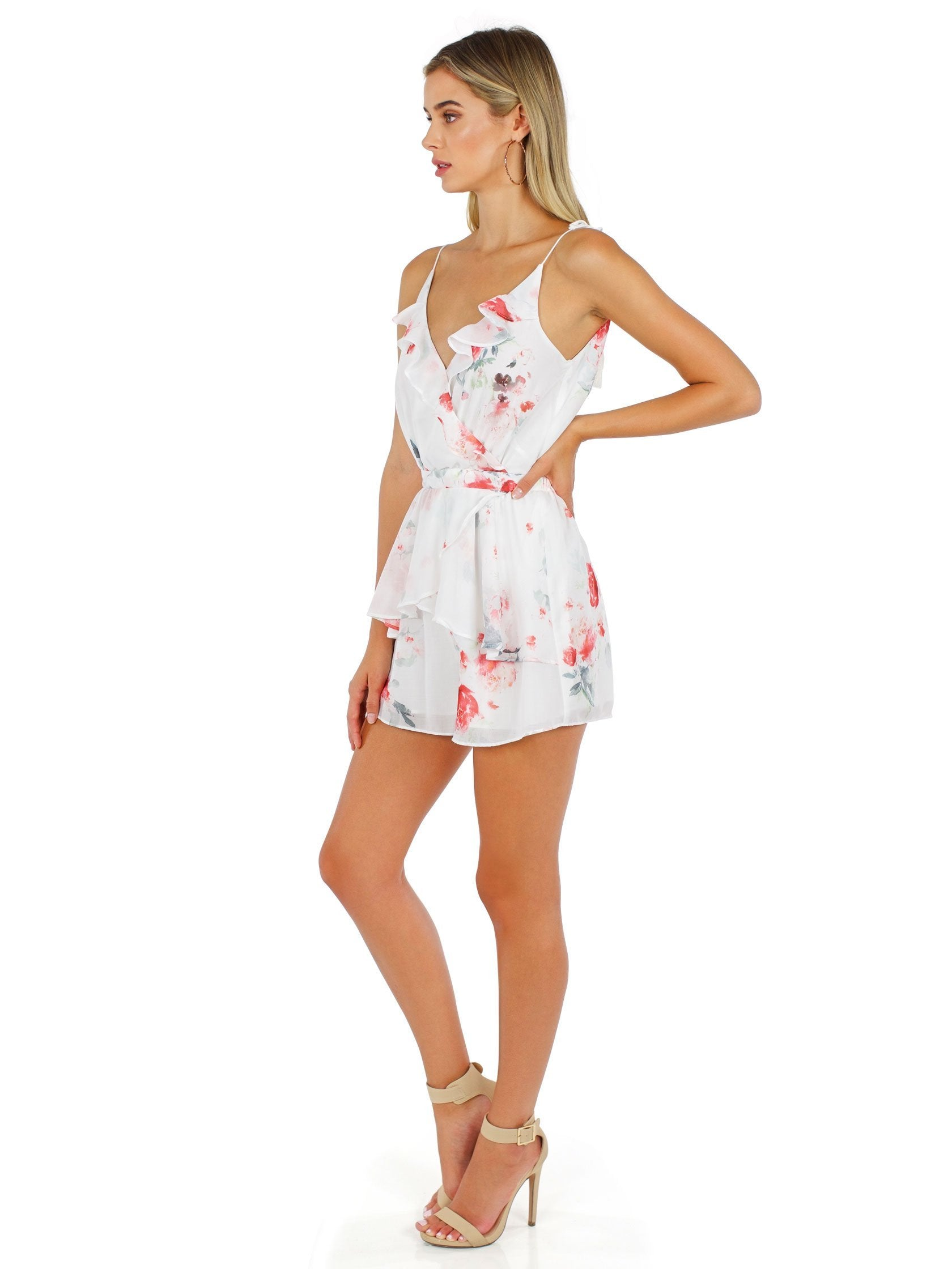 Woman wearing a romper rental from The Jetset Diaries called Isabella Romper