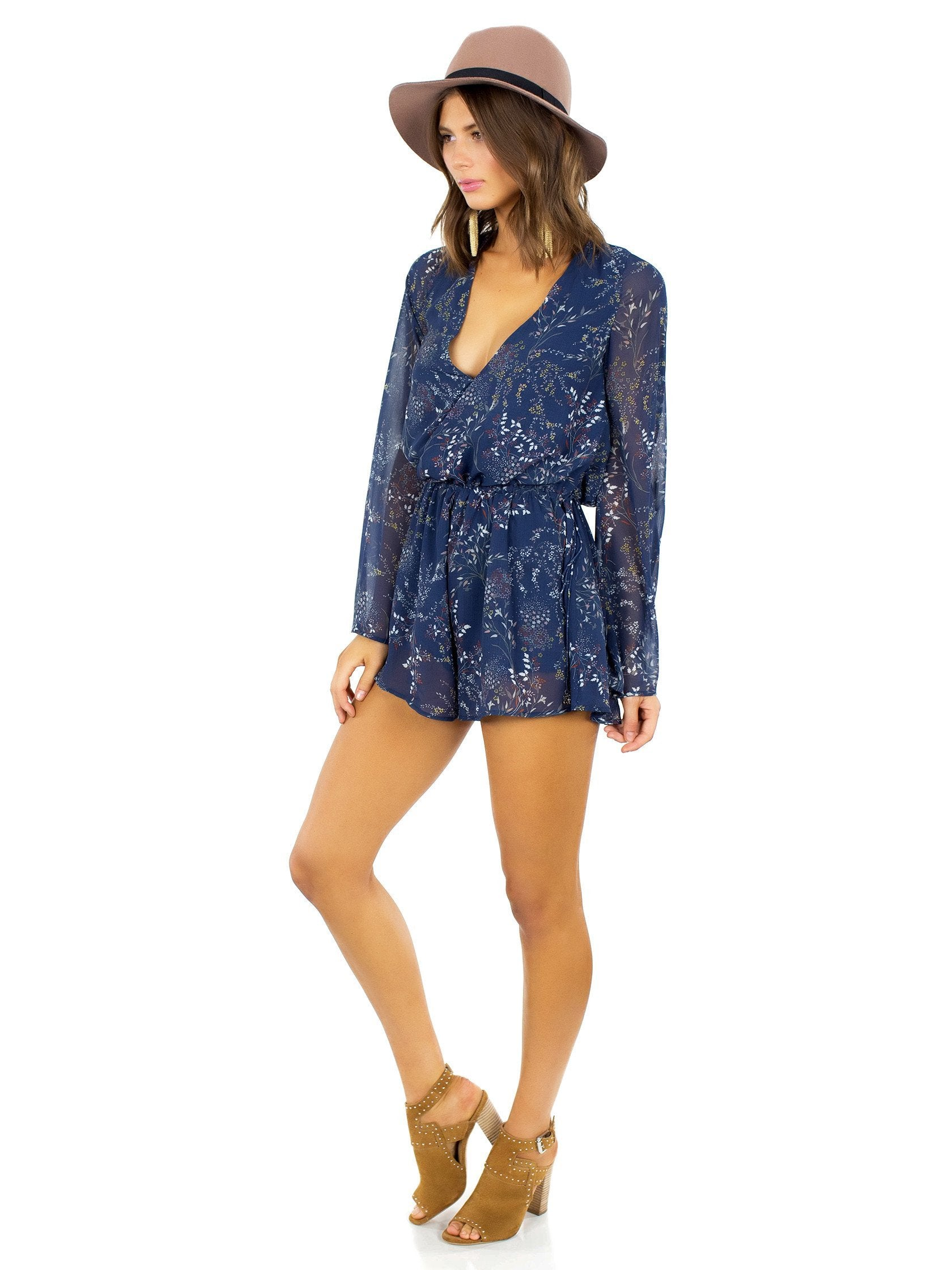 Woman wearing a romper rental from The Jetset Diaries called Mediterranean Romper
