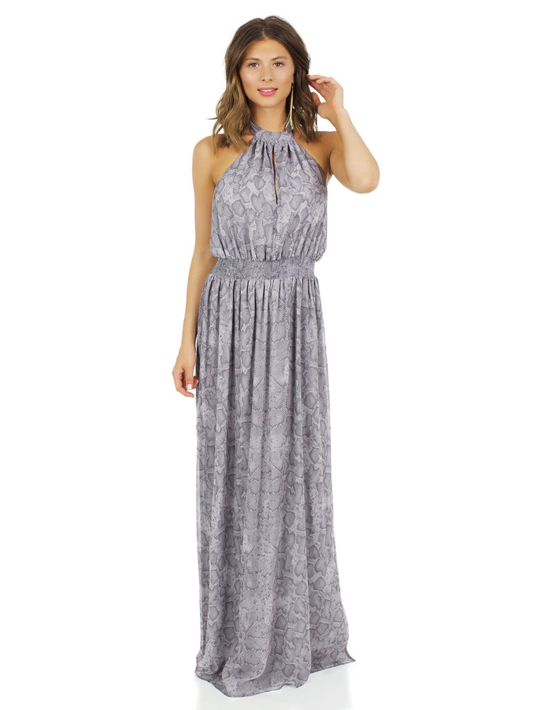 Woman wearing a dress rental from The Jetset Diaries called Gwyneth Ruffle Maxi Dress