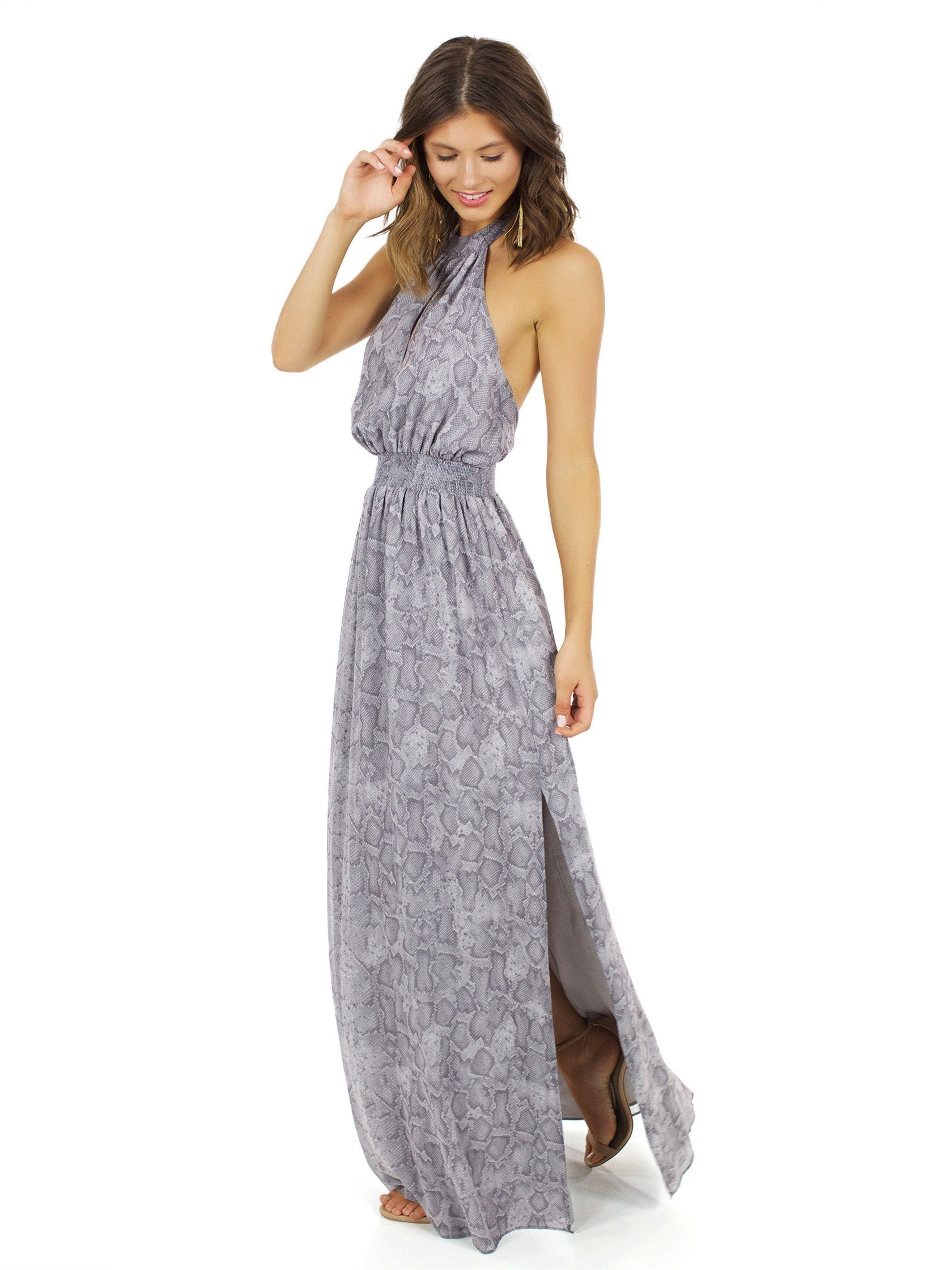 Woman wearing a dress rental from The Jetset Diaries called Medusa Maxi Dress
