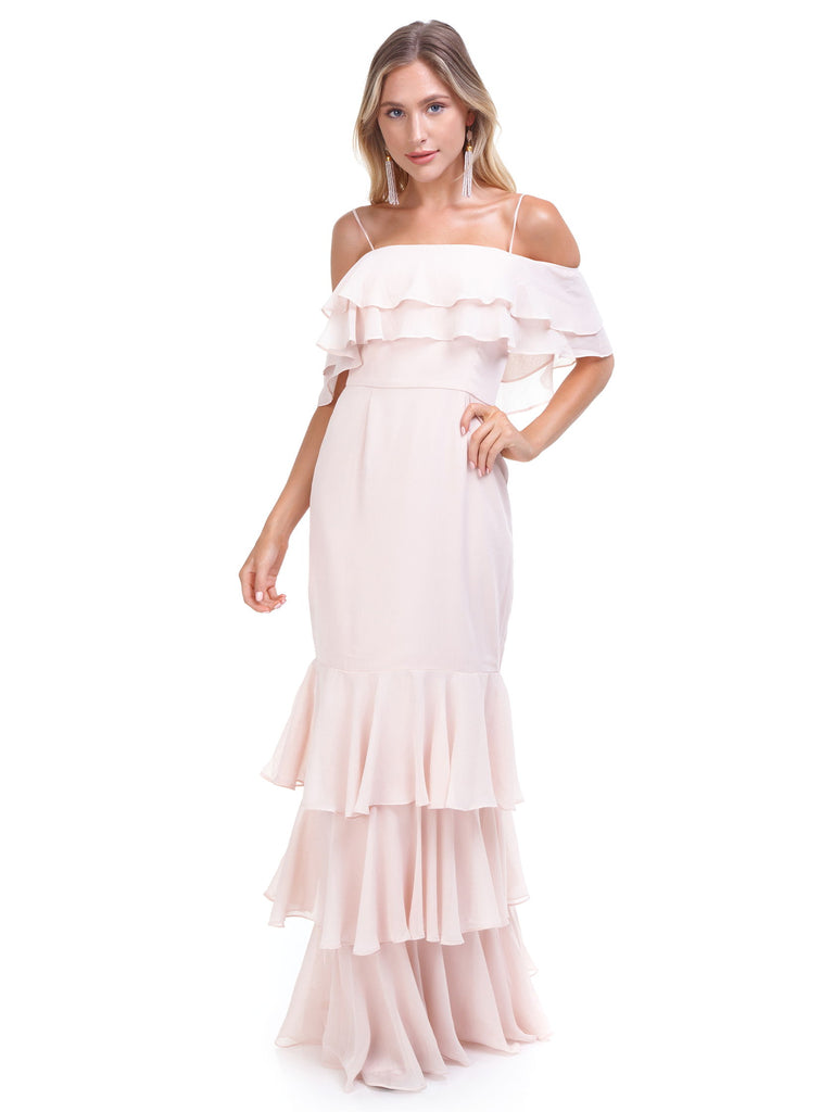Women wearing a dress rental from WAYF called Lauren Off Shoulder Ruffle Maxi Dress