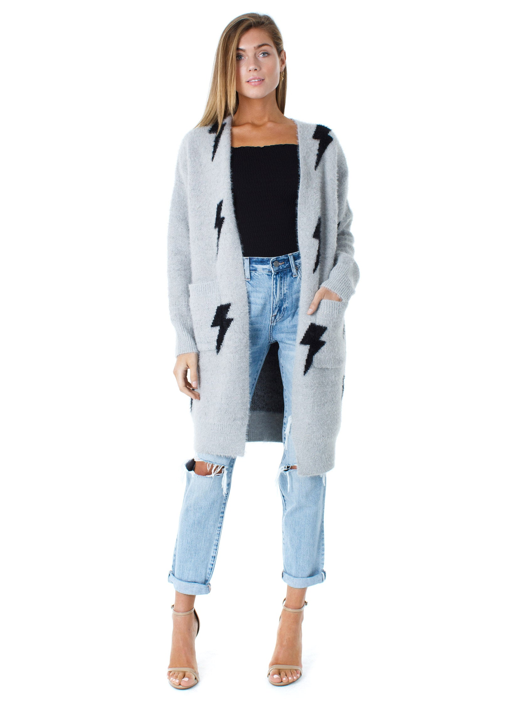 Woman wearing a cardigan rental from FashionPass called The Lightning Cardi