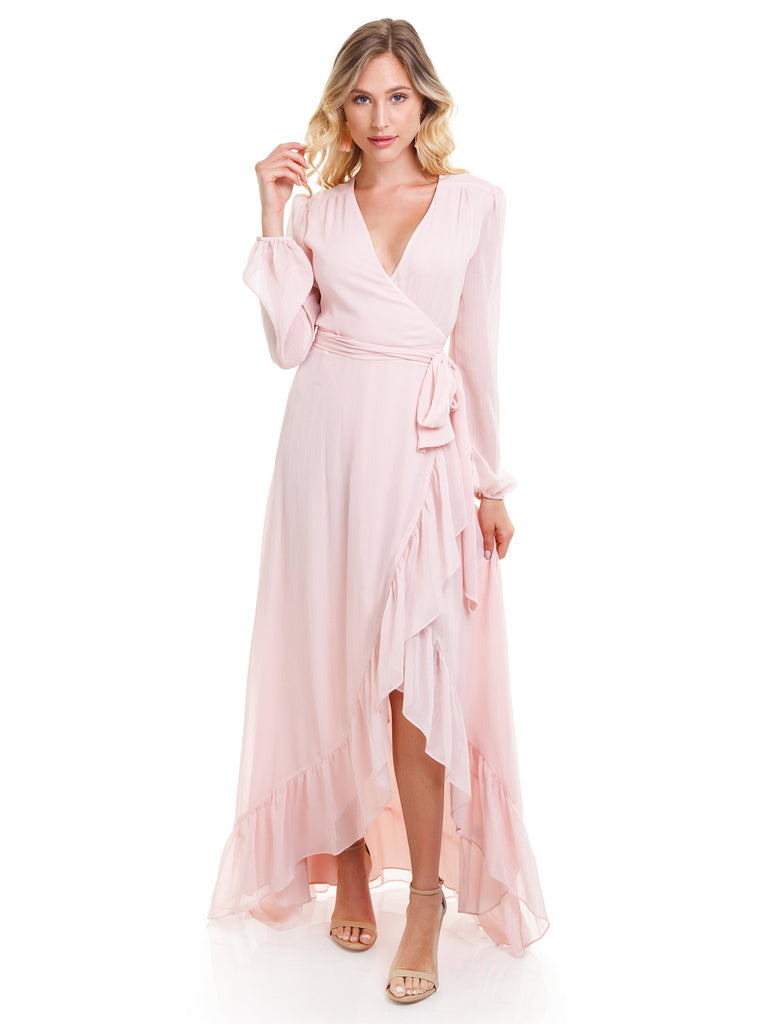 Women wearing a dress rental from WAYF called Meryl Long Sleeve Wrap Maxi Dress