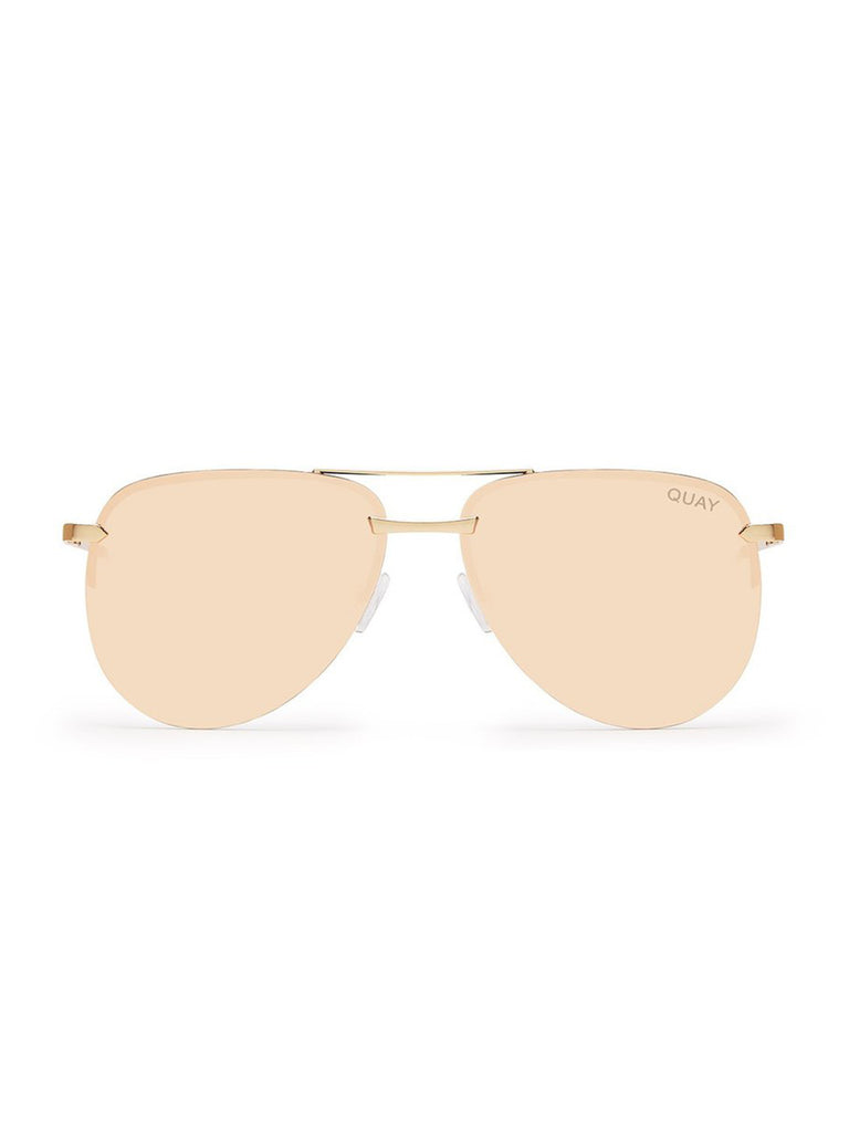 Woman wearing a sunglasses rental from Quay Australia called Lady Luck Sunglasses