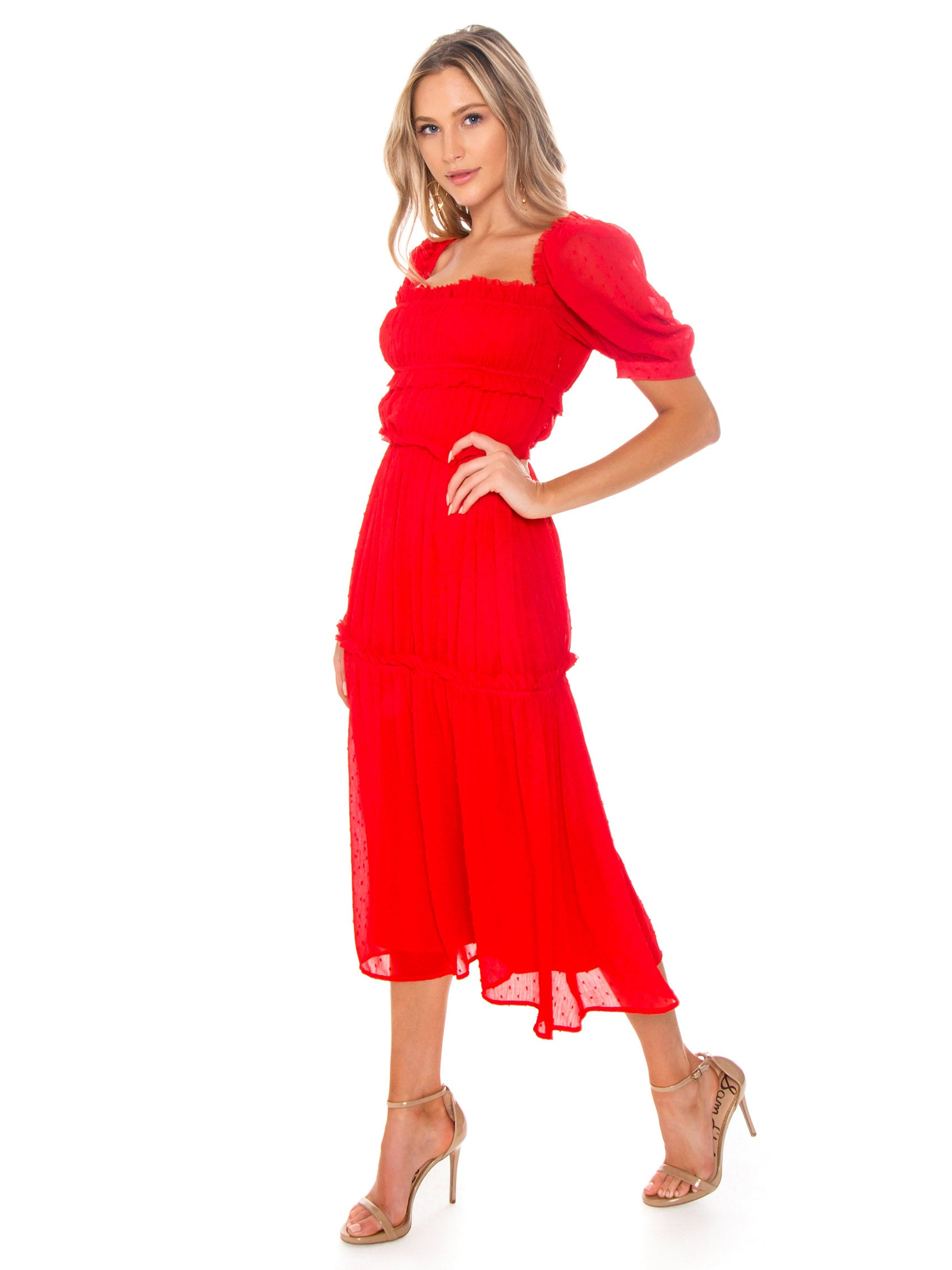 Woman wearing a dress rental from Lani The Label called The Poppy Dress