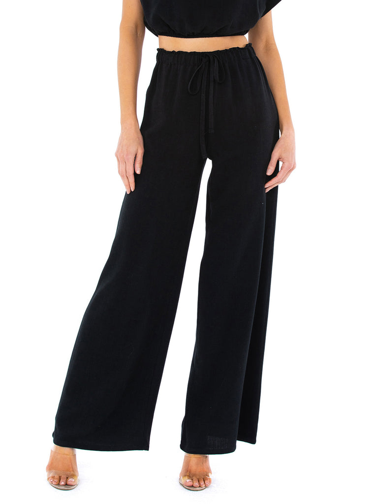 Women wearing a pants rental from STILLWATER called The Venice Wide Leg