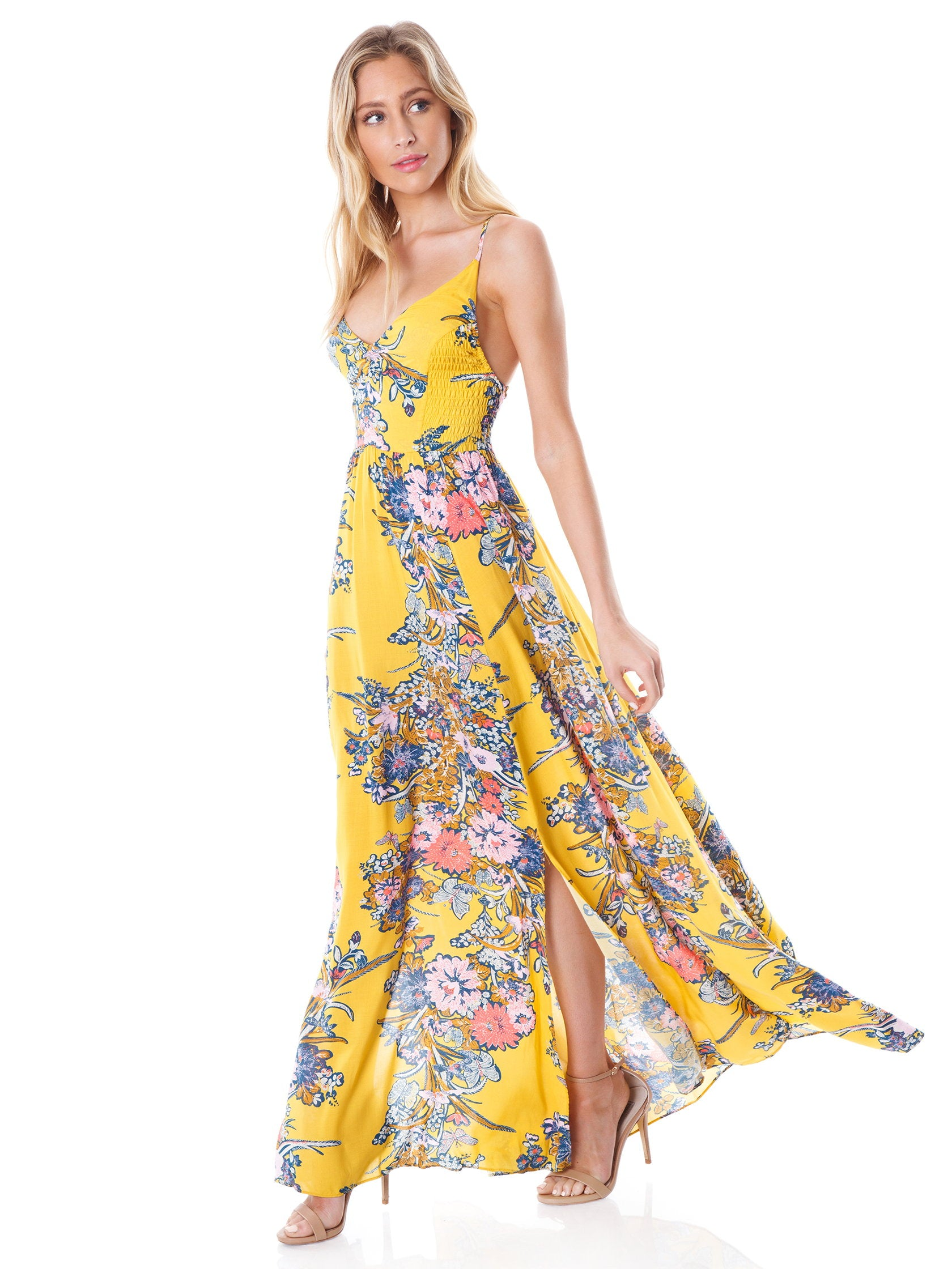ef19b64e093 Woman wearing a dress rental from Free People called Through The Vine  Printed Maxi Dress