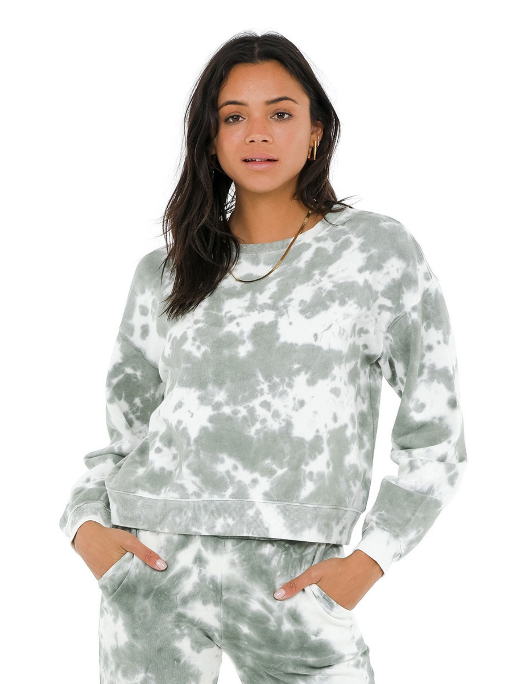 Woman wearing a sweatshirt rental from 525 called Tie Dye Basic Crew