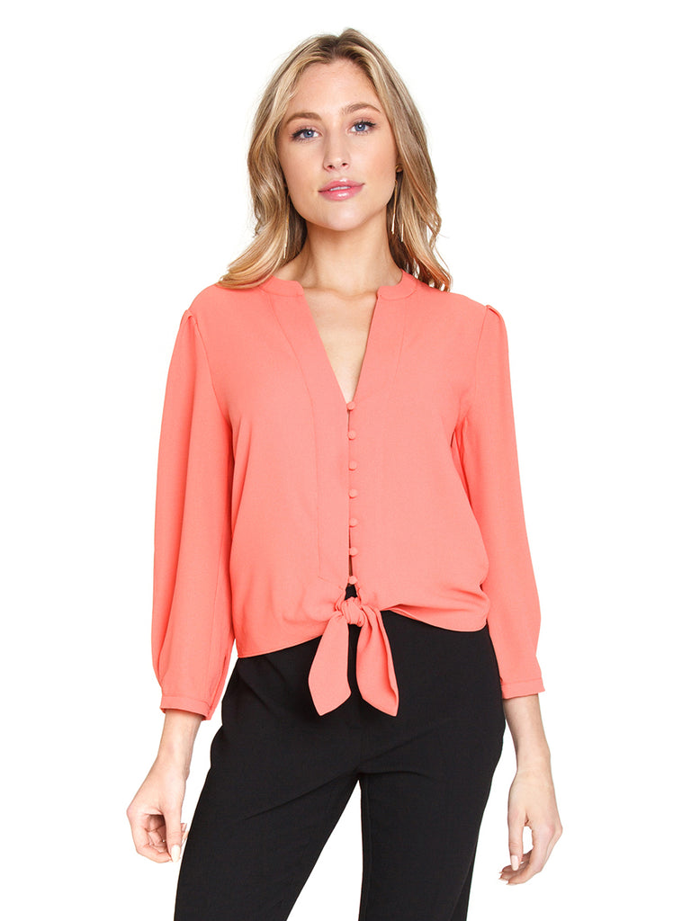 Woman wearing a top rental from 1.STATE called Tie Front Blouse