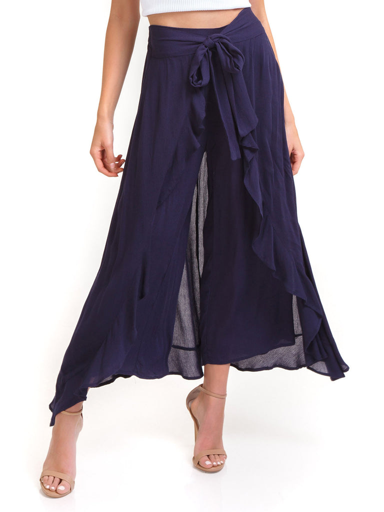 Woman wearing a pants rental from Moon River called Flutter Sleeve Wide Leg Jumpsuit