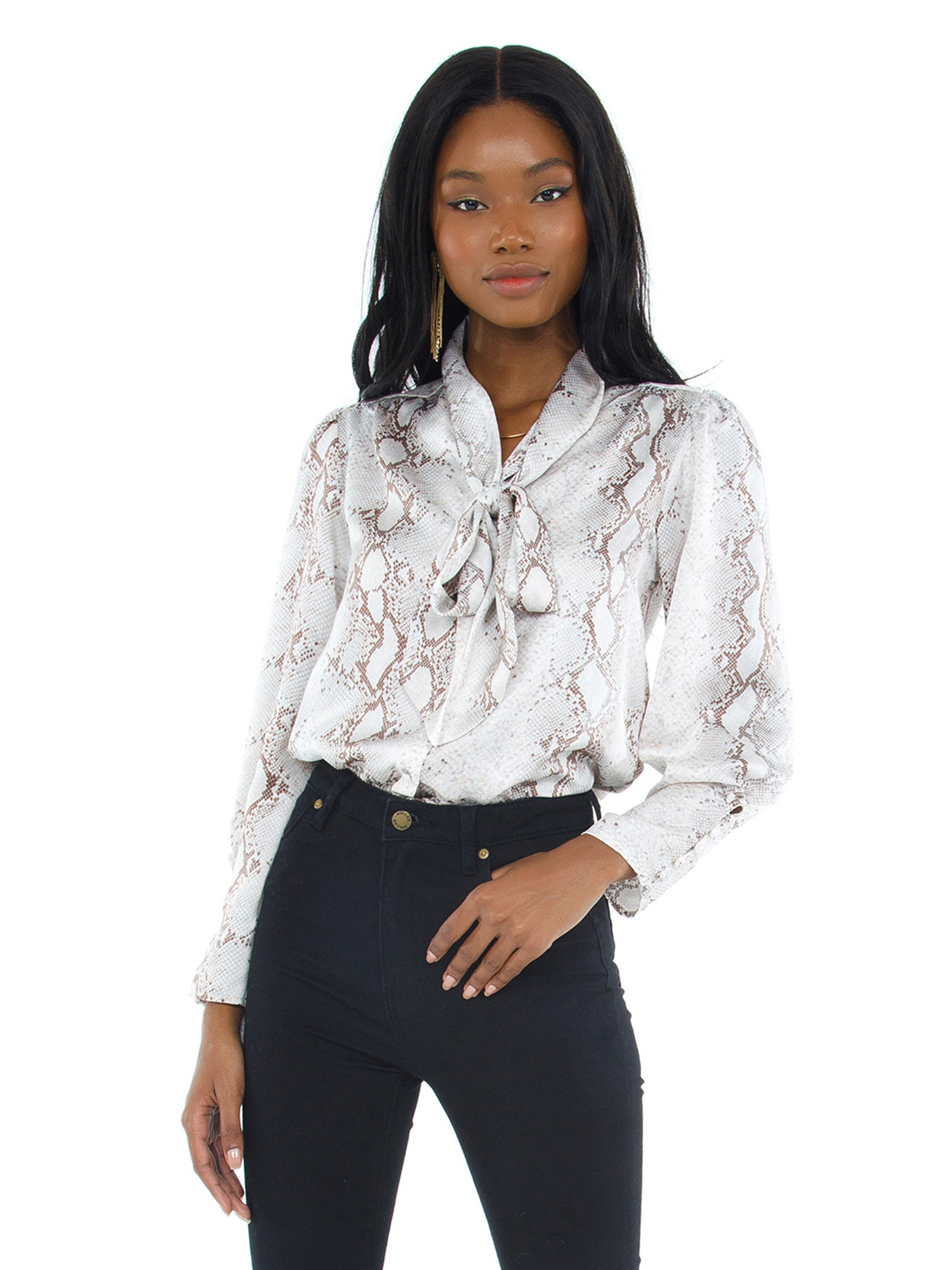 Girl outfit in a top rental from Bishop + Young called Tie Neck Blouse