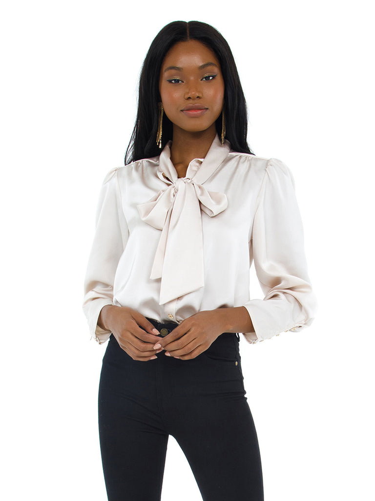 Girl wearing a top rental from Bishop + Young called Tie Neck Blouse