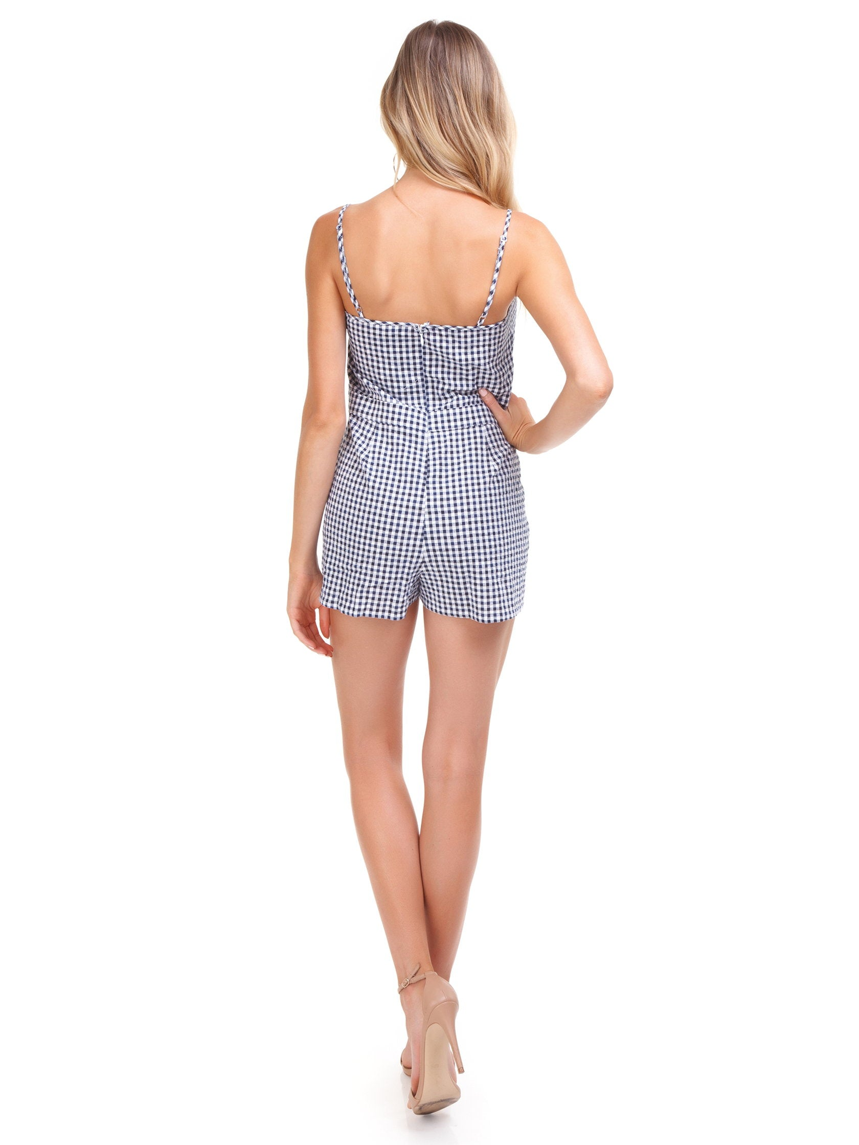 Women wearing a romper rental from Blue Life called Tied Up Romper