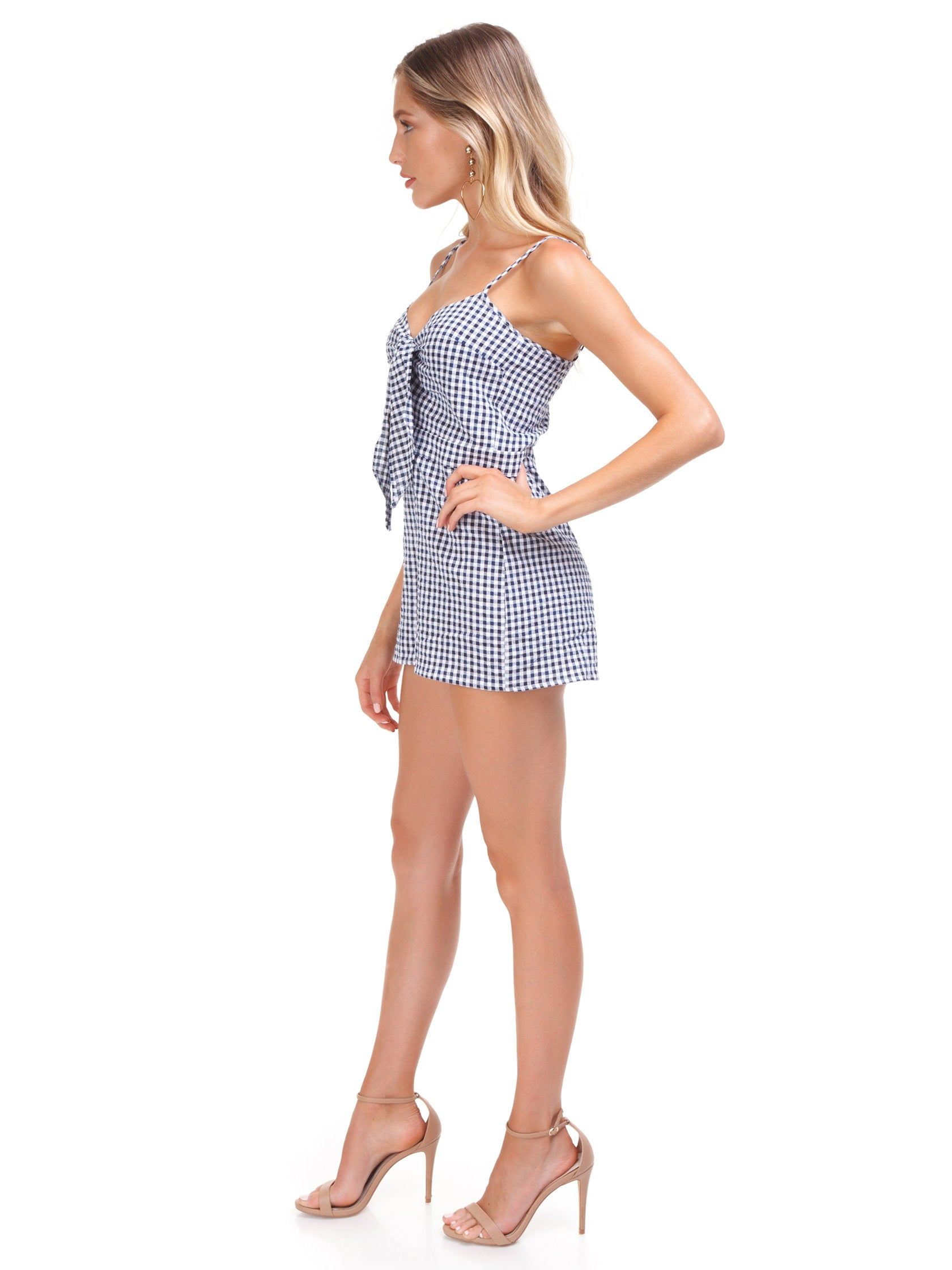 Woman wearing a romper rental from Blue Life called Tied Up Romper