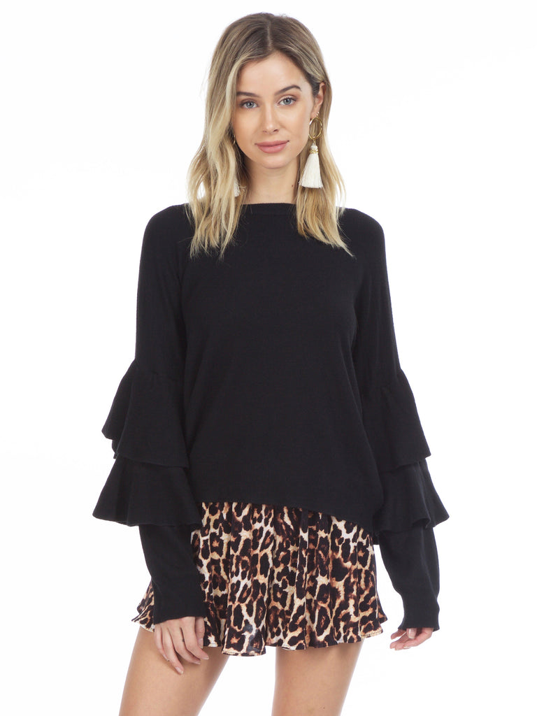 Women wearing a sweater rental from Strut & Bolt called Tiered Sleeve Ruffle Sweater