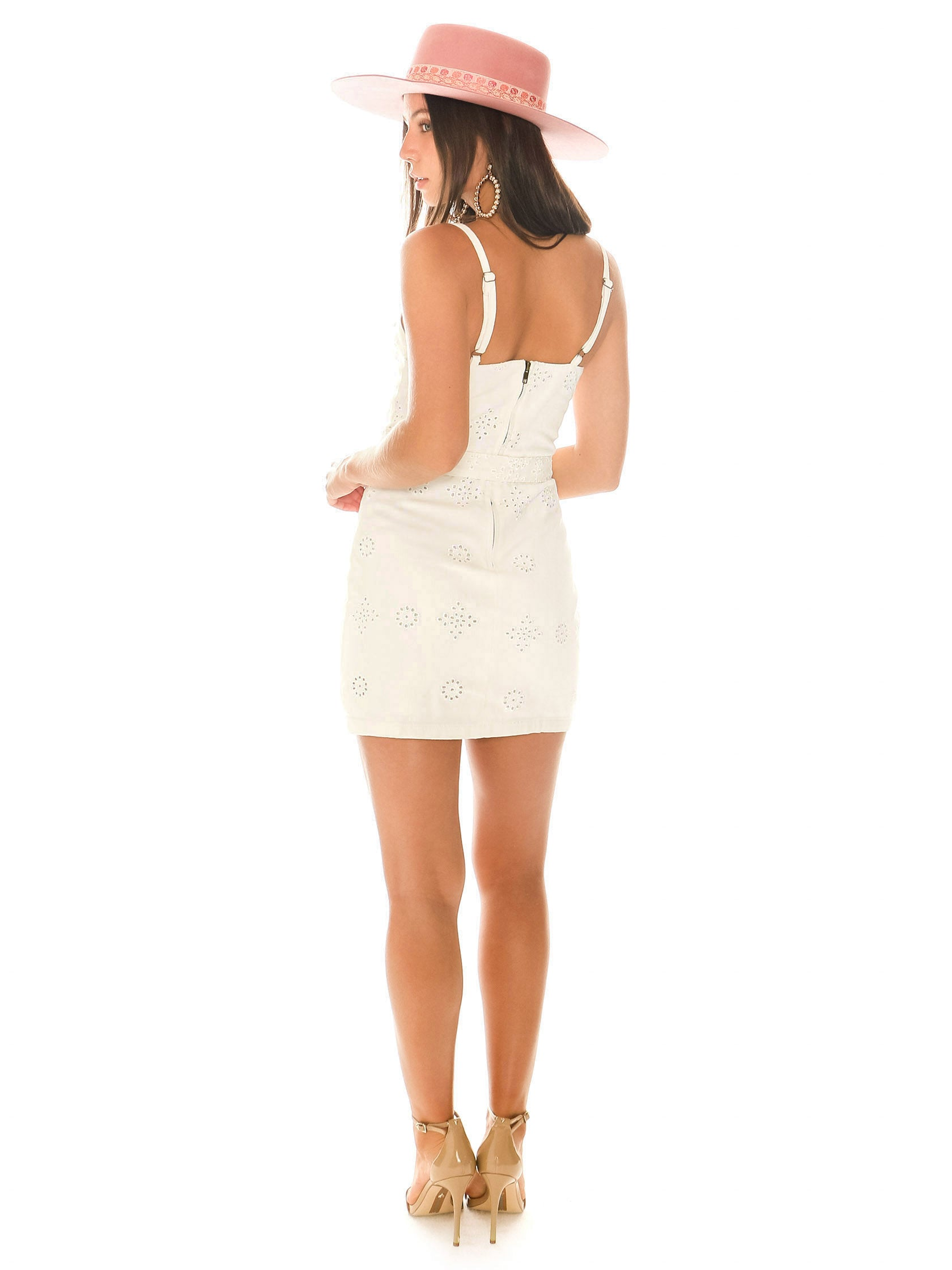 Women wearing a dress rental from MINKPINK called To The Coast Broidery Mini Dress