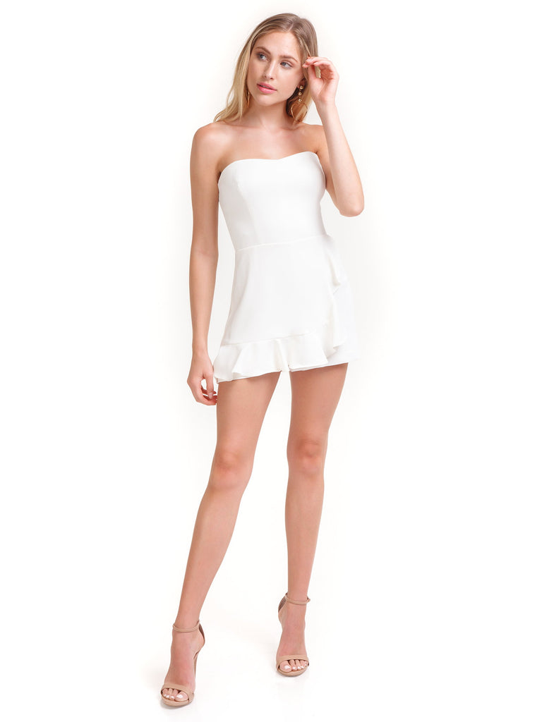 Woman wearing a romper rental from Amanda Uprichard called Dance Till Dawn Romper