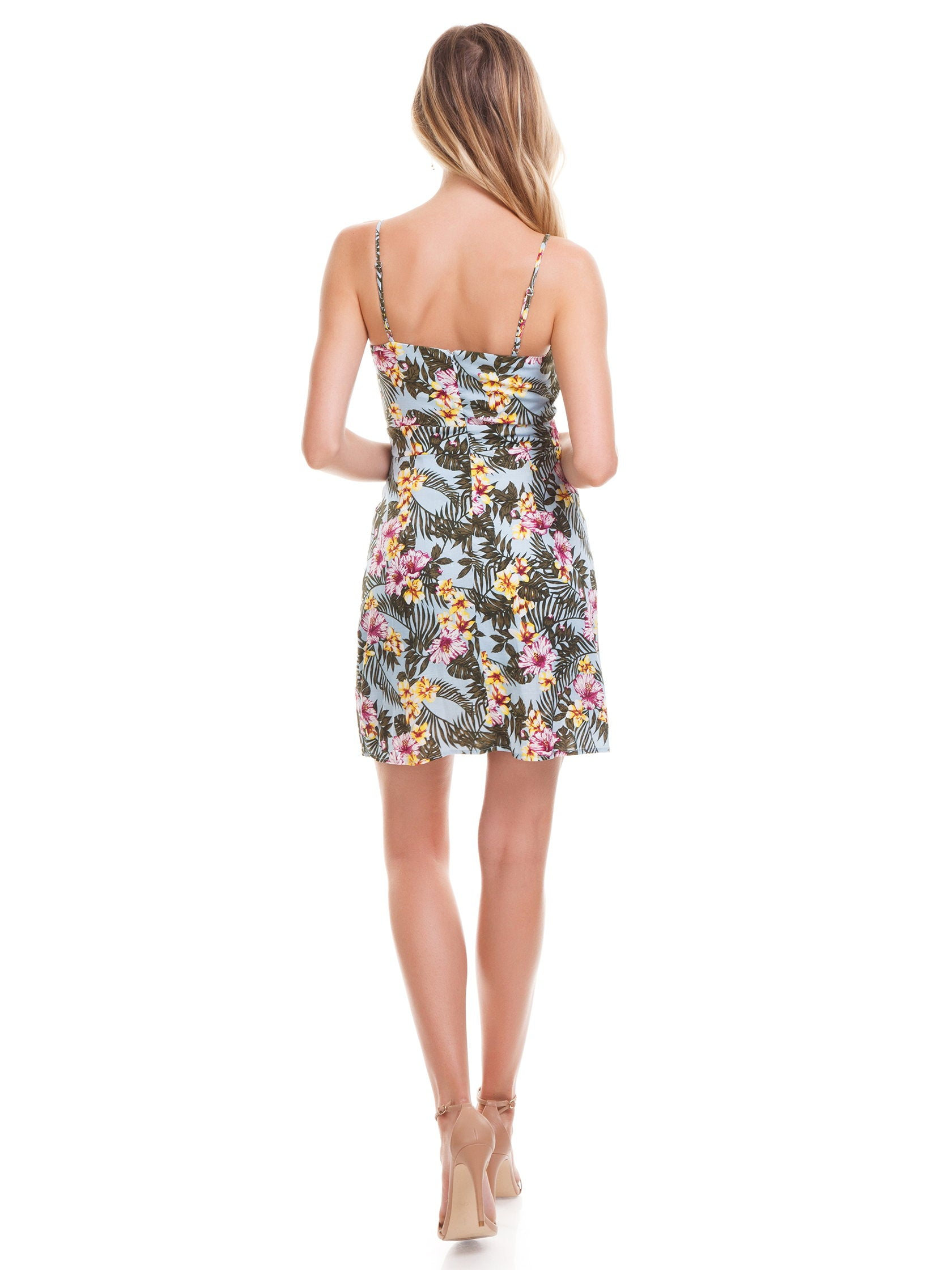 Women wearing a dress rental from J.O.A. called Tropical Print Faux Wrap Dress