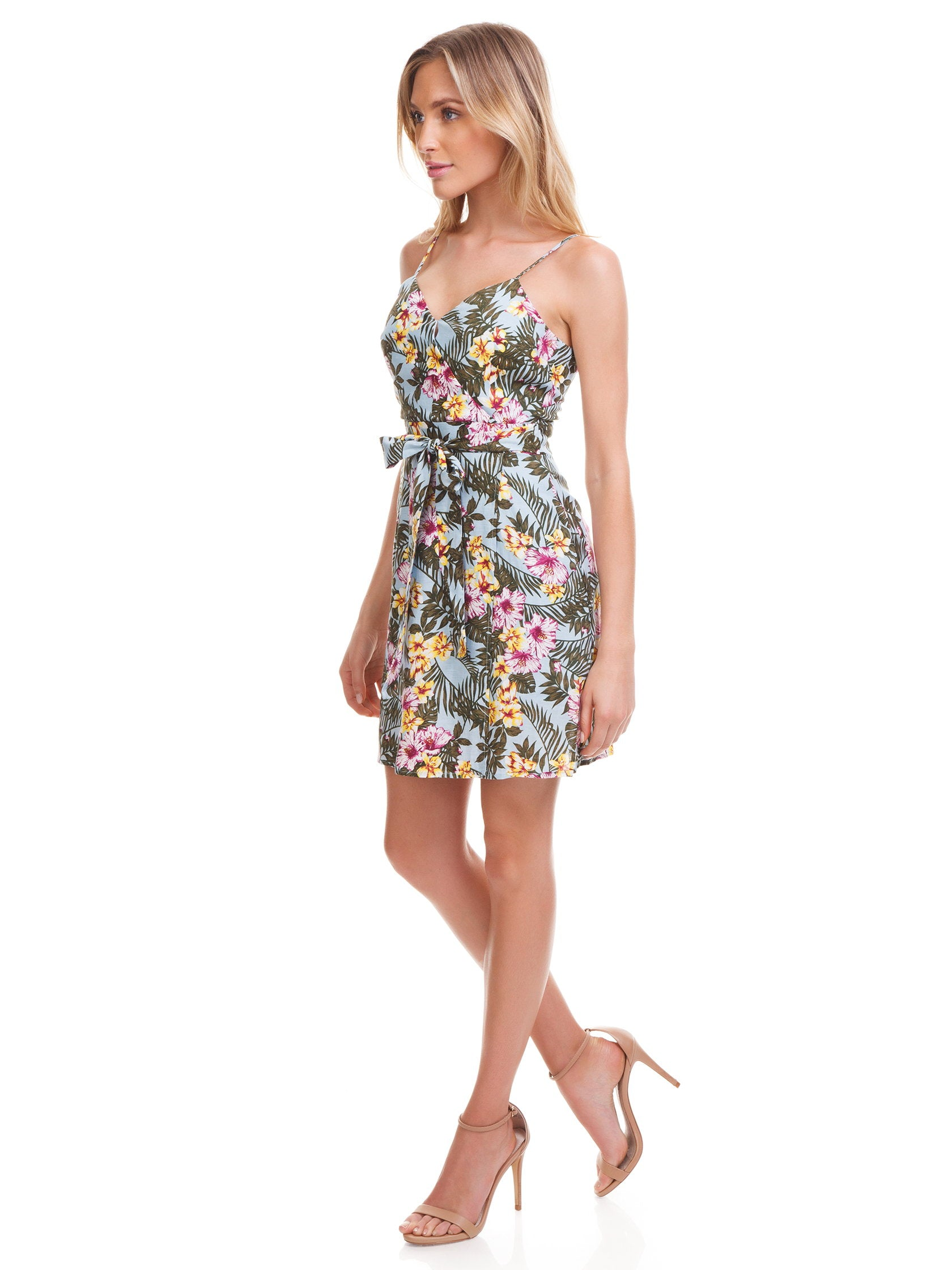 Woman wearing a dress rental from J.O.A. called Tropical Print Faux Wrap Dress