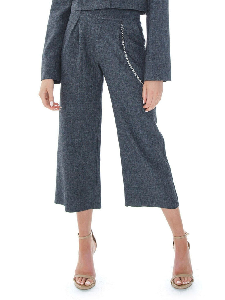 Women wearing a pants rental from For Love & Lemons called Turner Wide Leg Pant