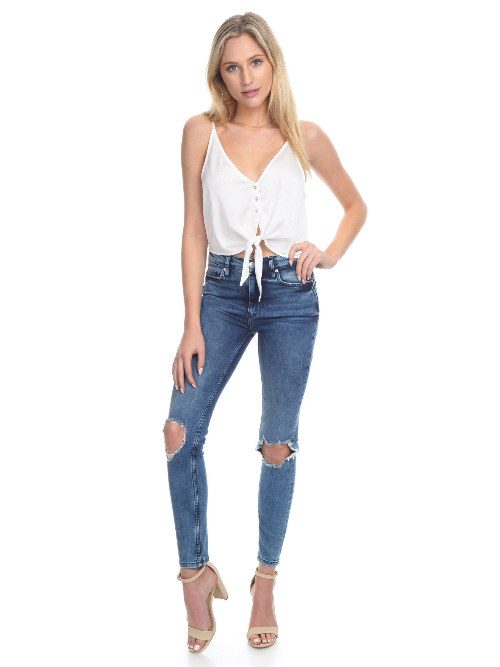 Girl outfit in a denim rental from Free People called High Rise Busted Skinny Jeans