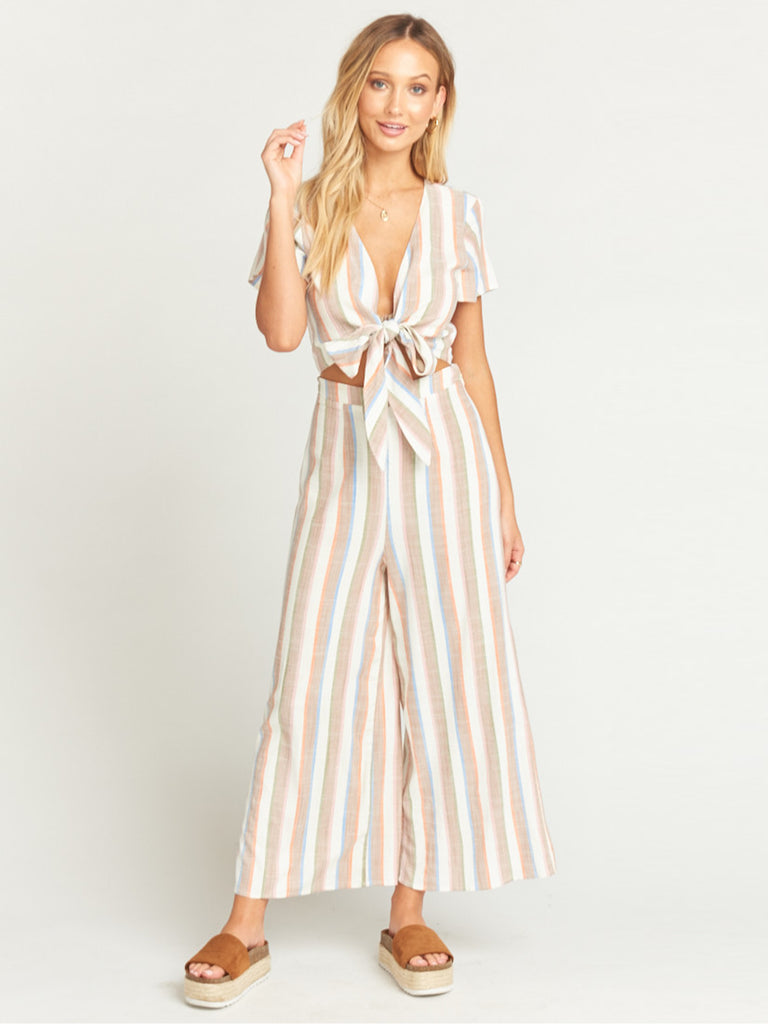 Girl outfit in a jumpsuit rental from Show Me Your Mumu called Cropped Varsity Vacay Sweater