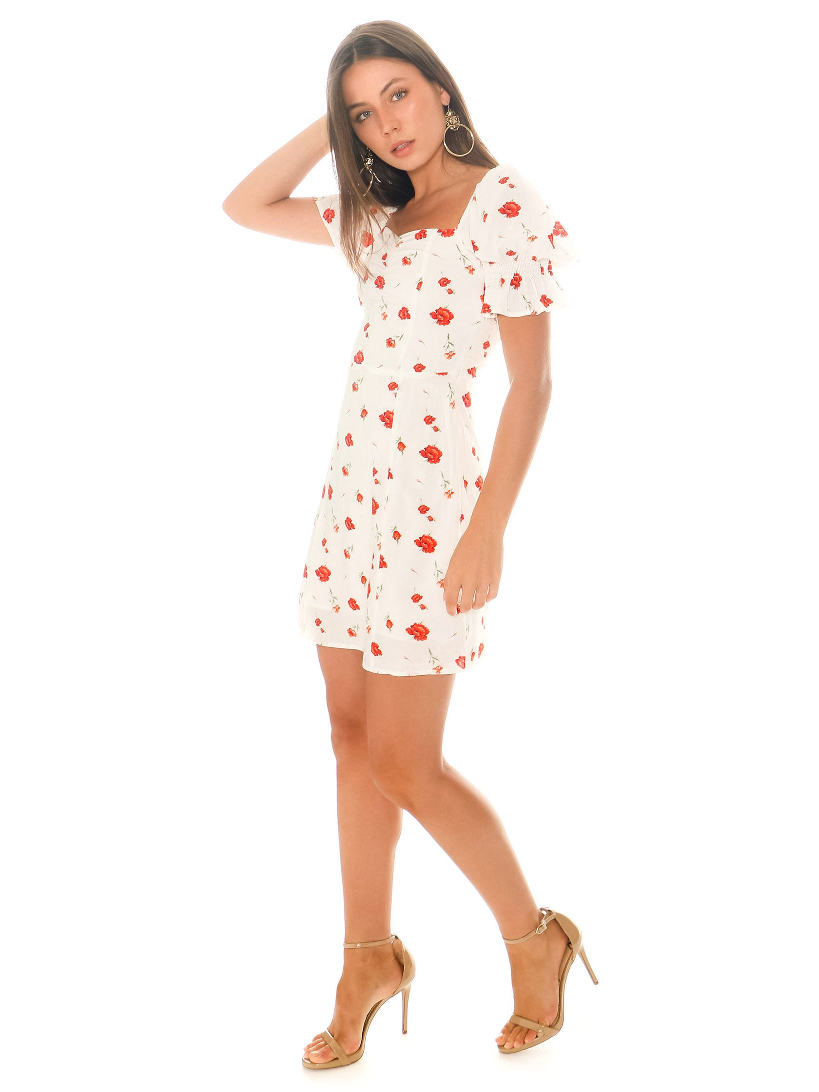 Woman wearing a dress rental from Charlie Holiday called Valentine Floral Mini Dress