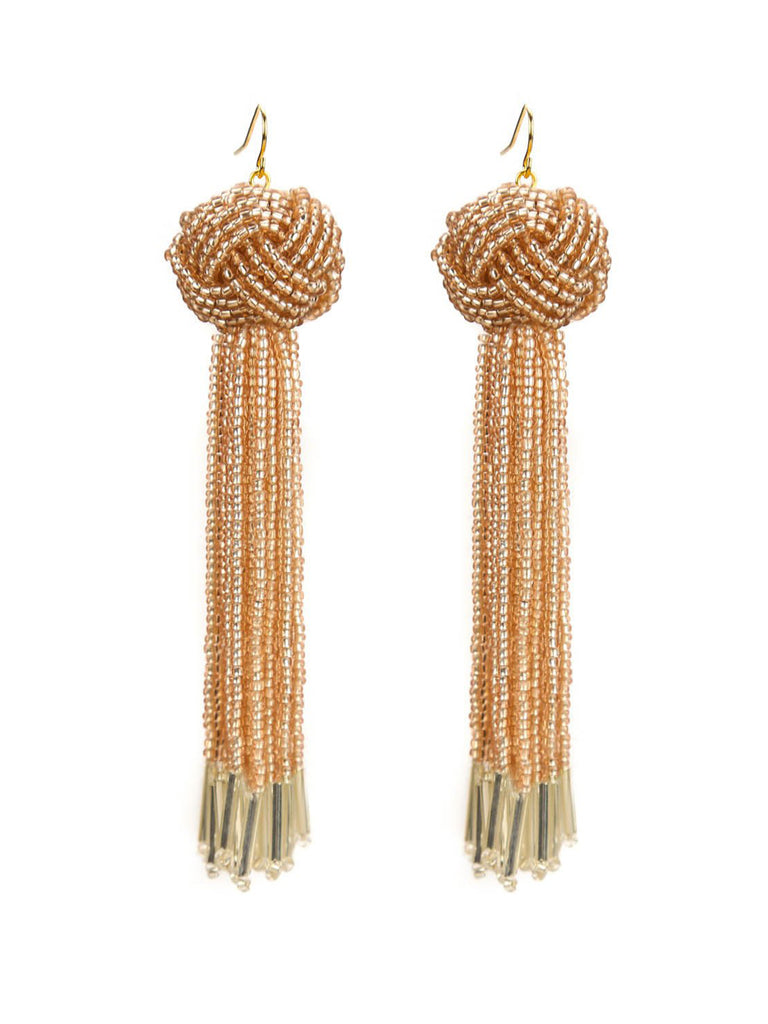 Women outfit in a earrings rental from Vanessa Mooney called Ellie Coral Tassel Earrings