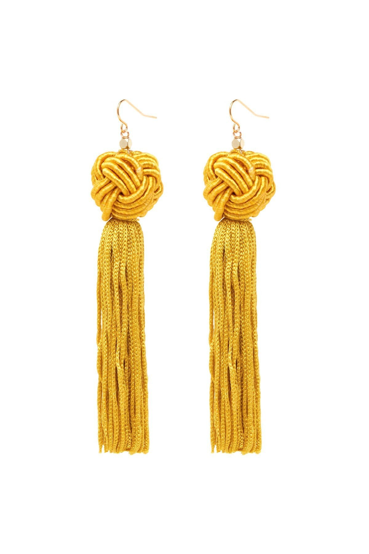 Girl wearing a earrings rental from Vanessa Mooney called The Astrid Gold Knotted Tassel Earrings