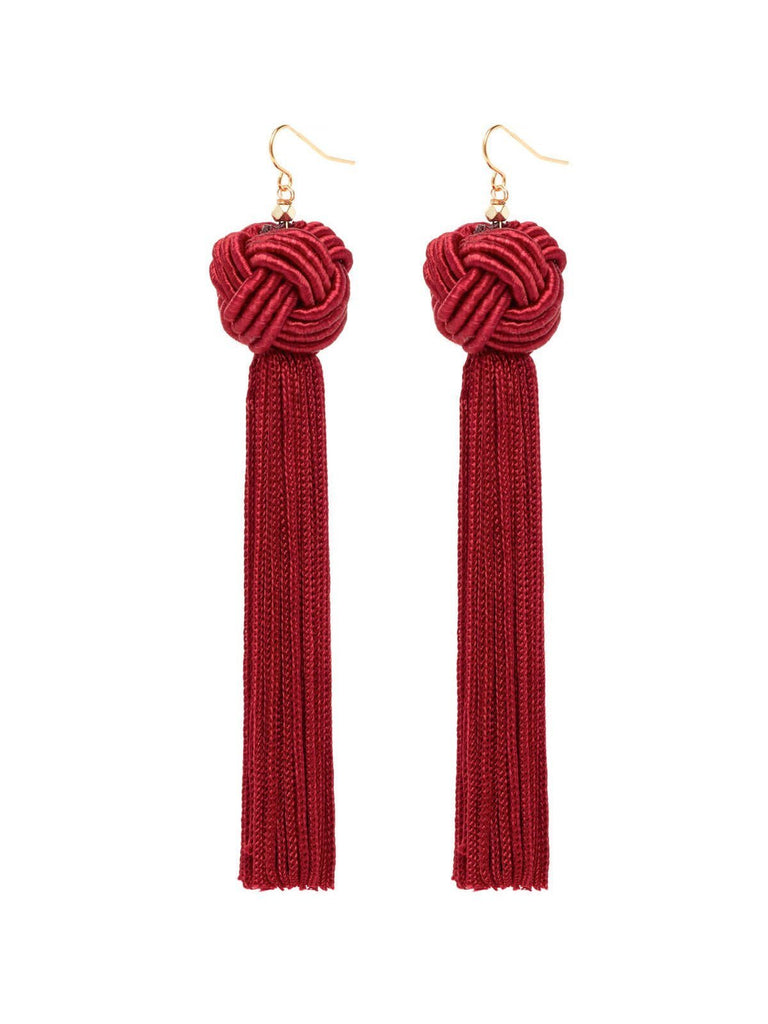 Women wearing a earrings rental from Vanessa Mooney called The Astrid Knotted Tassel Earrings