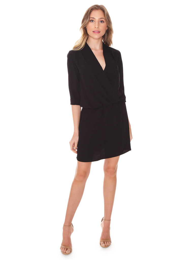 Girl outfit in a dress rental from Amanda Uprichard called Velvet Flutter Sleeve Wrap Dress