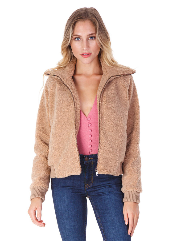 Women outfit in a jacket rental from Line & Dot called Mena Fur Coat