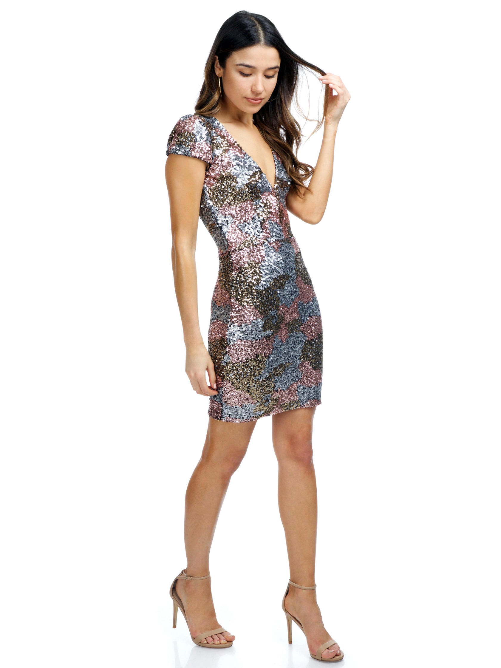 Woman wearing a dress rental from Dress the Population called Victoria Sequin Dress