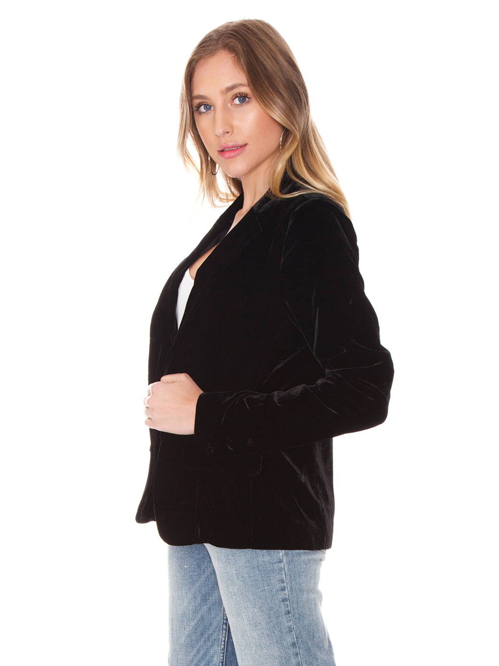 Women wearing a blazer rental from For Love & Lemons called Viva Velvet Blazer