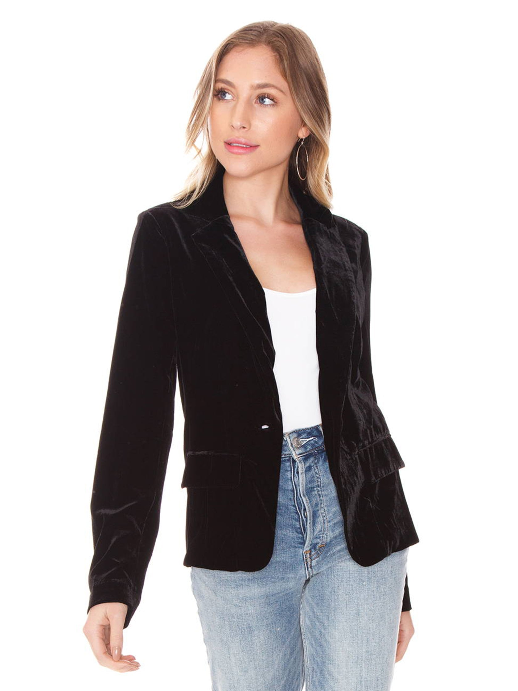 Woman wearing a blazer rental from For Love & Lemons called Viva Velvet Blazer