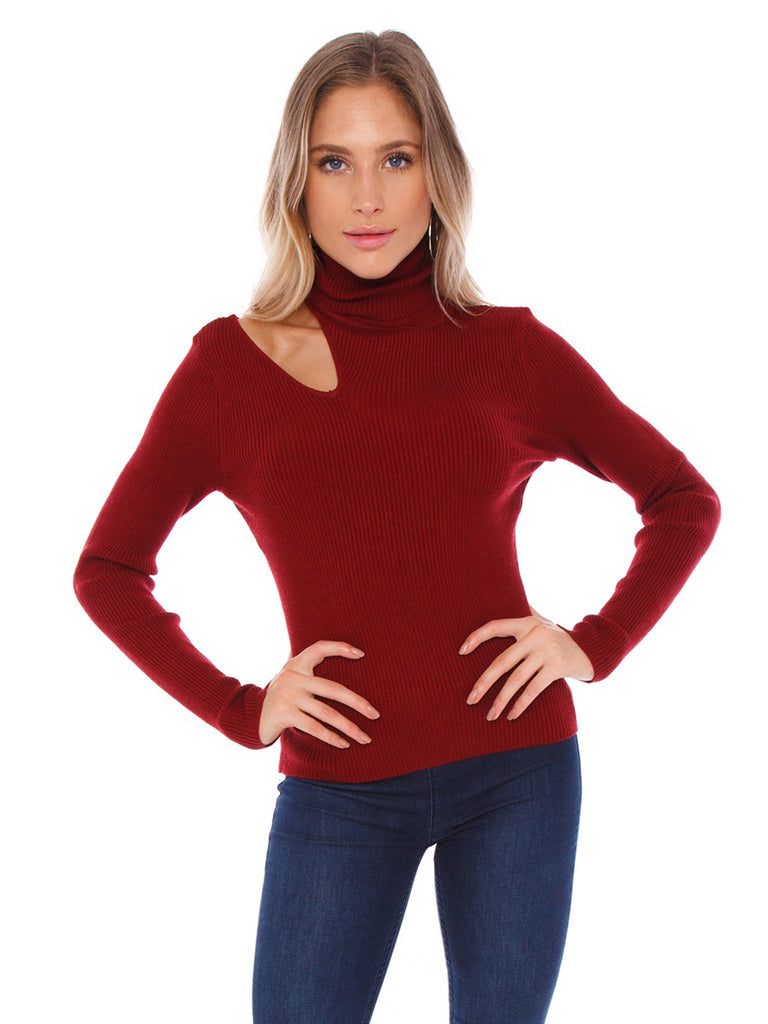 Woman wearing a sweater rental from ASTR called Darla Top