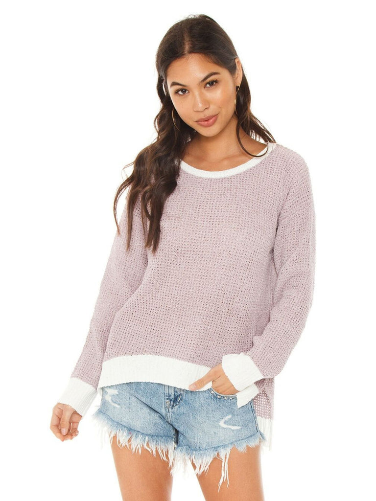 Women wearing a sweater rental from FashionPass called Waffle Knit