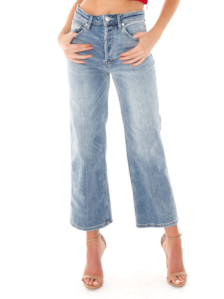 Woman wearing a denim rental from Free People called Zephyr Legging