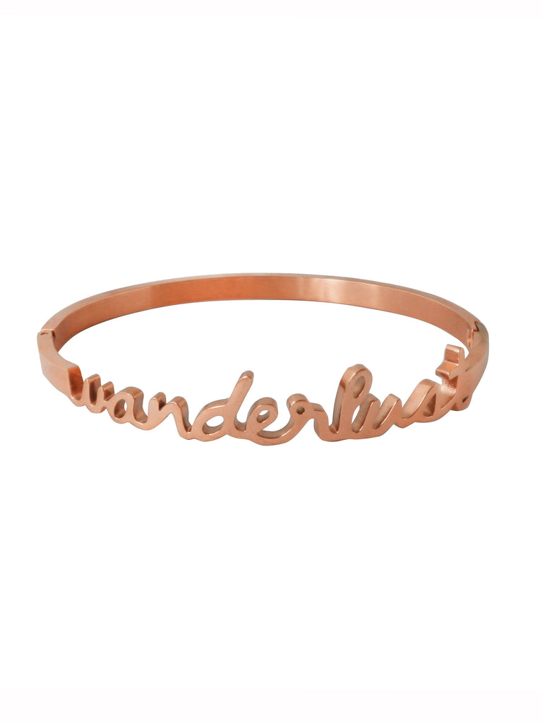 Women wearing a bracelet rental from Wanderlust + Co called Zodiac Gold Ring (select Your Sign)