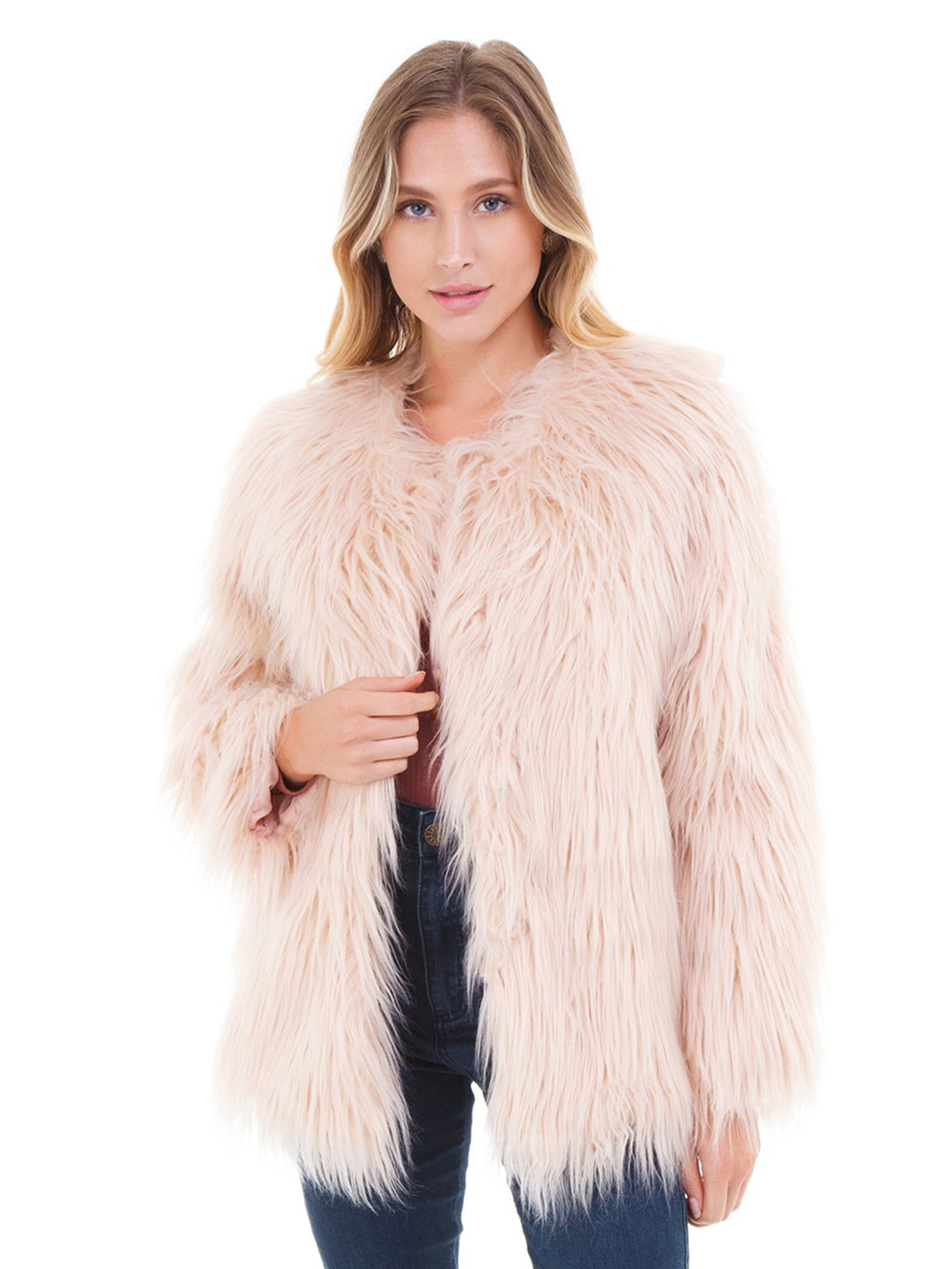 Woman wearing a jacket rental from LOST + WANDER called Warm Me Up Faux Fur Jacket