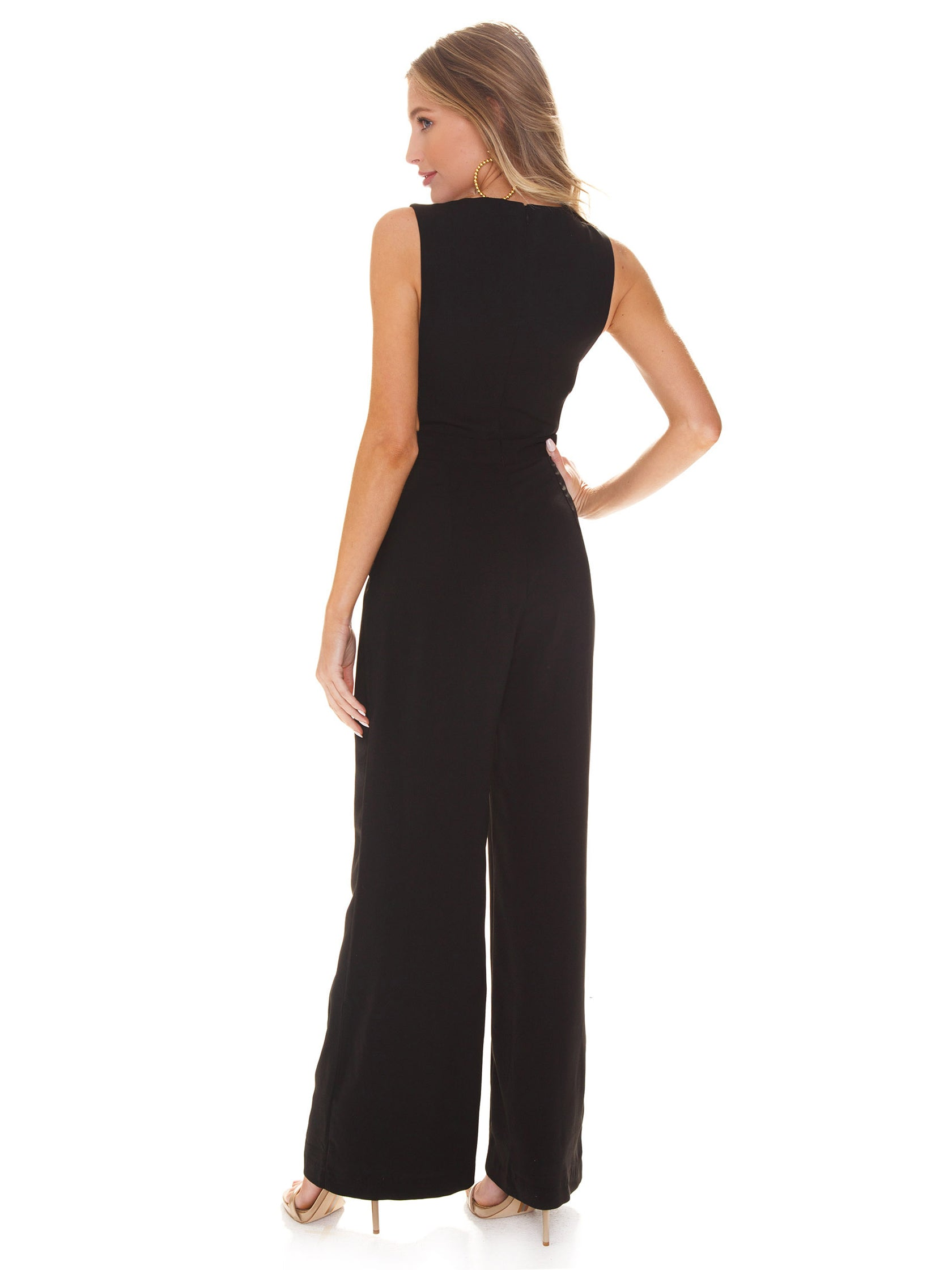 Women wearing a jumpsuit rental from WAYF called Wayland Banded Jumpsuit