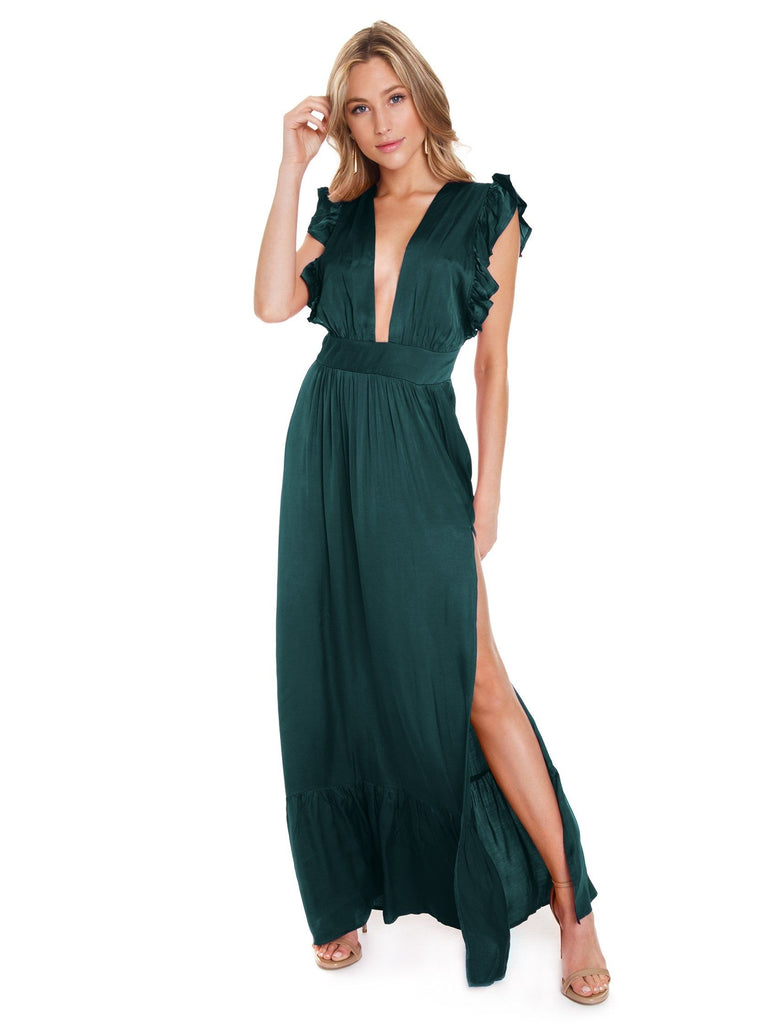 Women outfit in a dress rental from STILLWATER called Cinched Sleeve Woodland Ditsy Wrap Dress