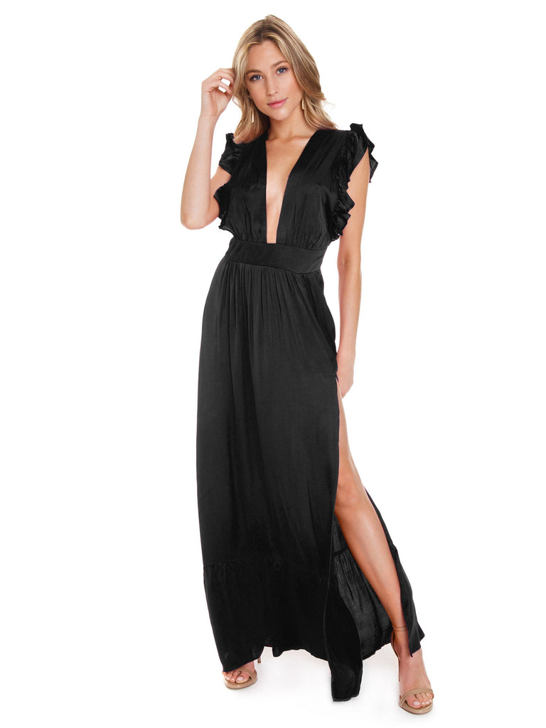 Woman wearing a dress rental from STILLWATER called Allira Maxi Dress