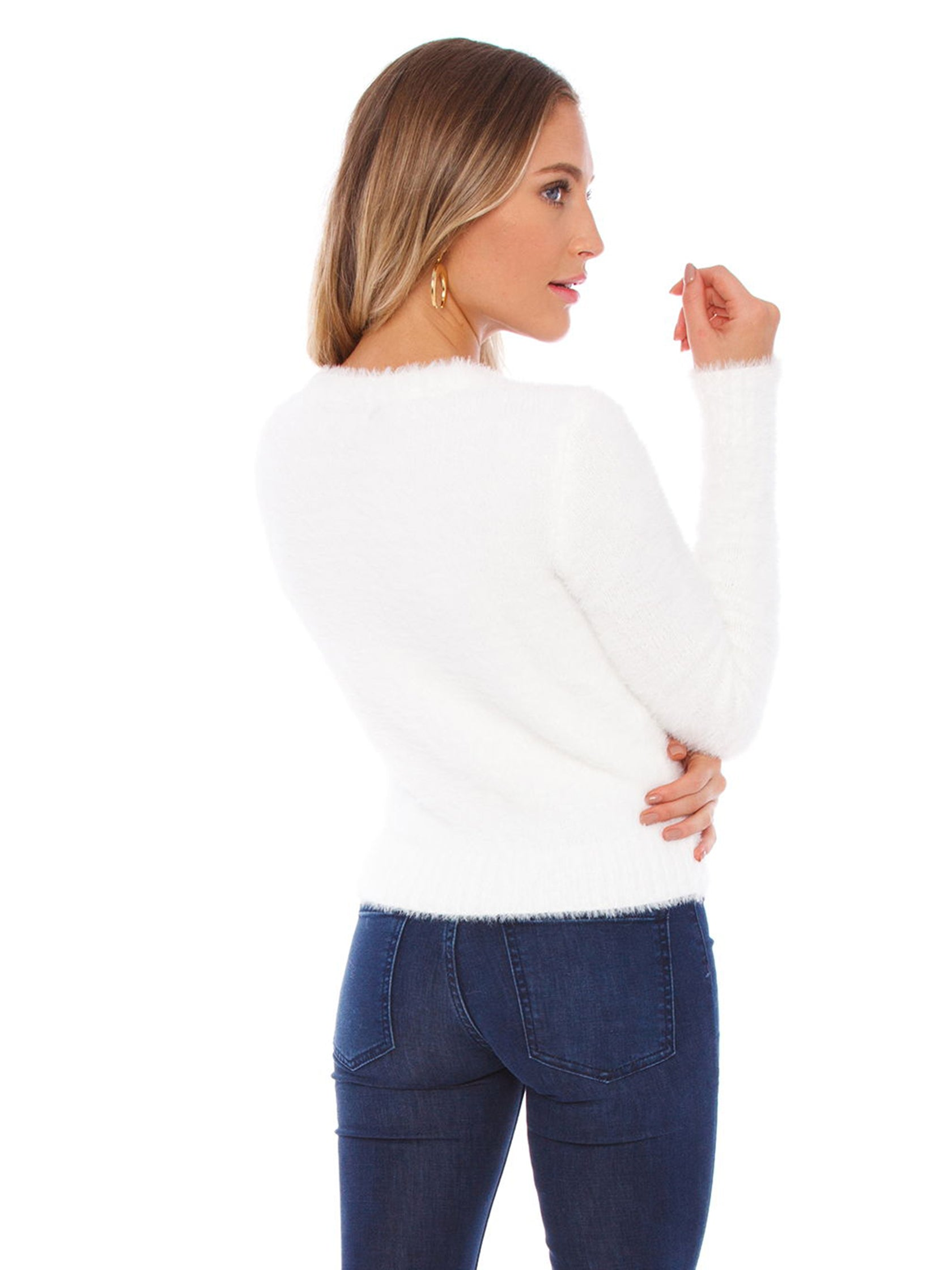 Women outfit in a sweater rental from FASHIONPASS called White As Snow Sweater