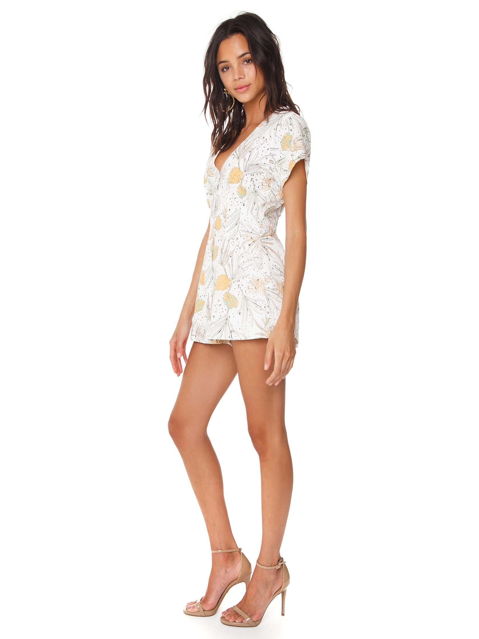 Woman wearing a romper rental from MINKPINK called Wild Coast Playsuit